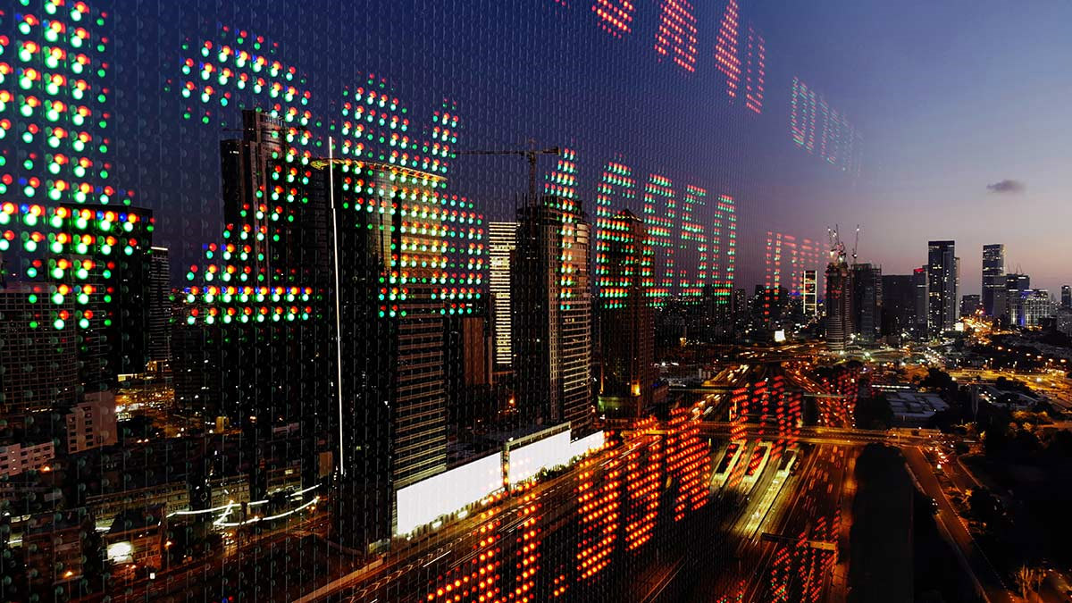 Stock prices with a city in the background