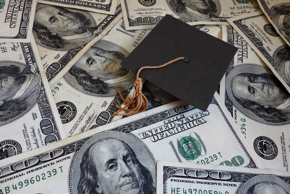 Currency Dollars and Graduation Cap