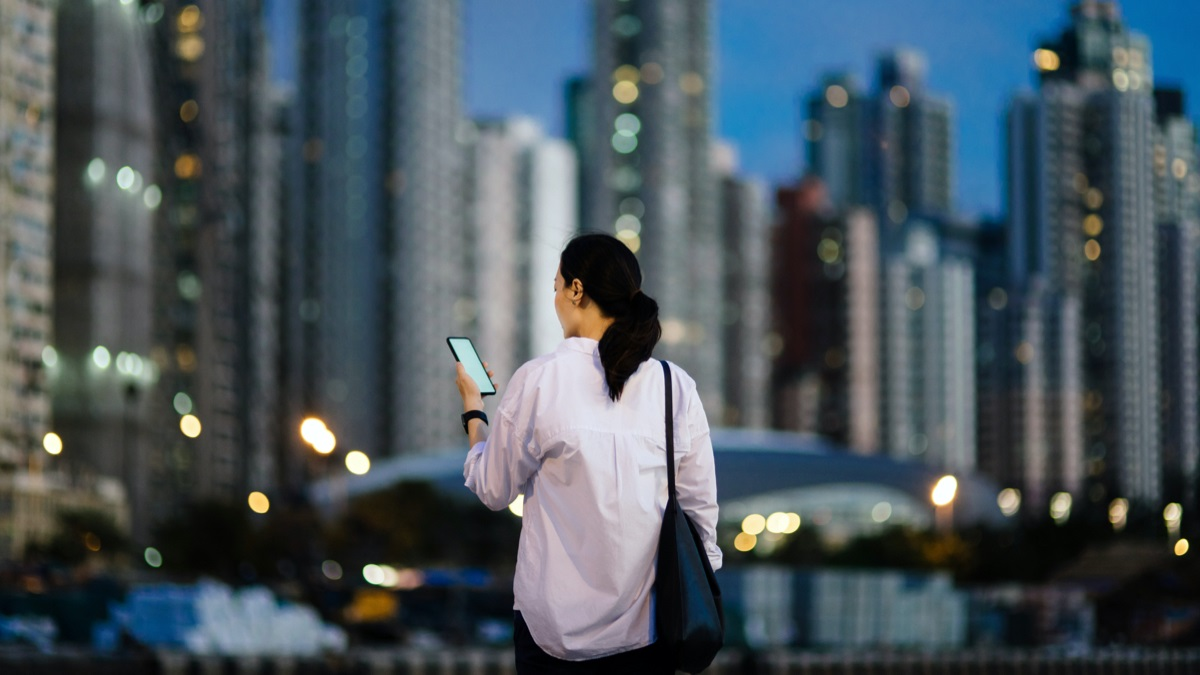 Lady looking at cell phone in urban environment